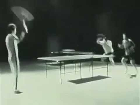Bruce Lee playing ping pong