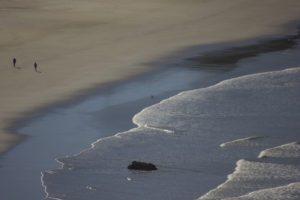 People walking on the beach in Oregon
